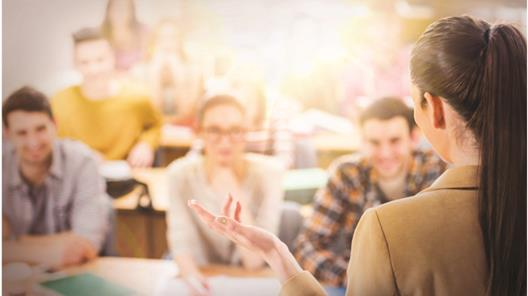 Teacher gives lecture to class
