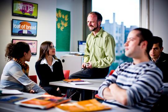 Teachers discussing in a classroom
