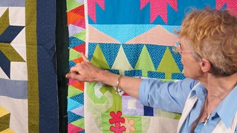 Adding border and scrappy edging Jennie's Stripy Stripey Story Quilt