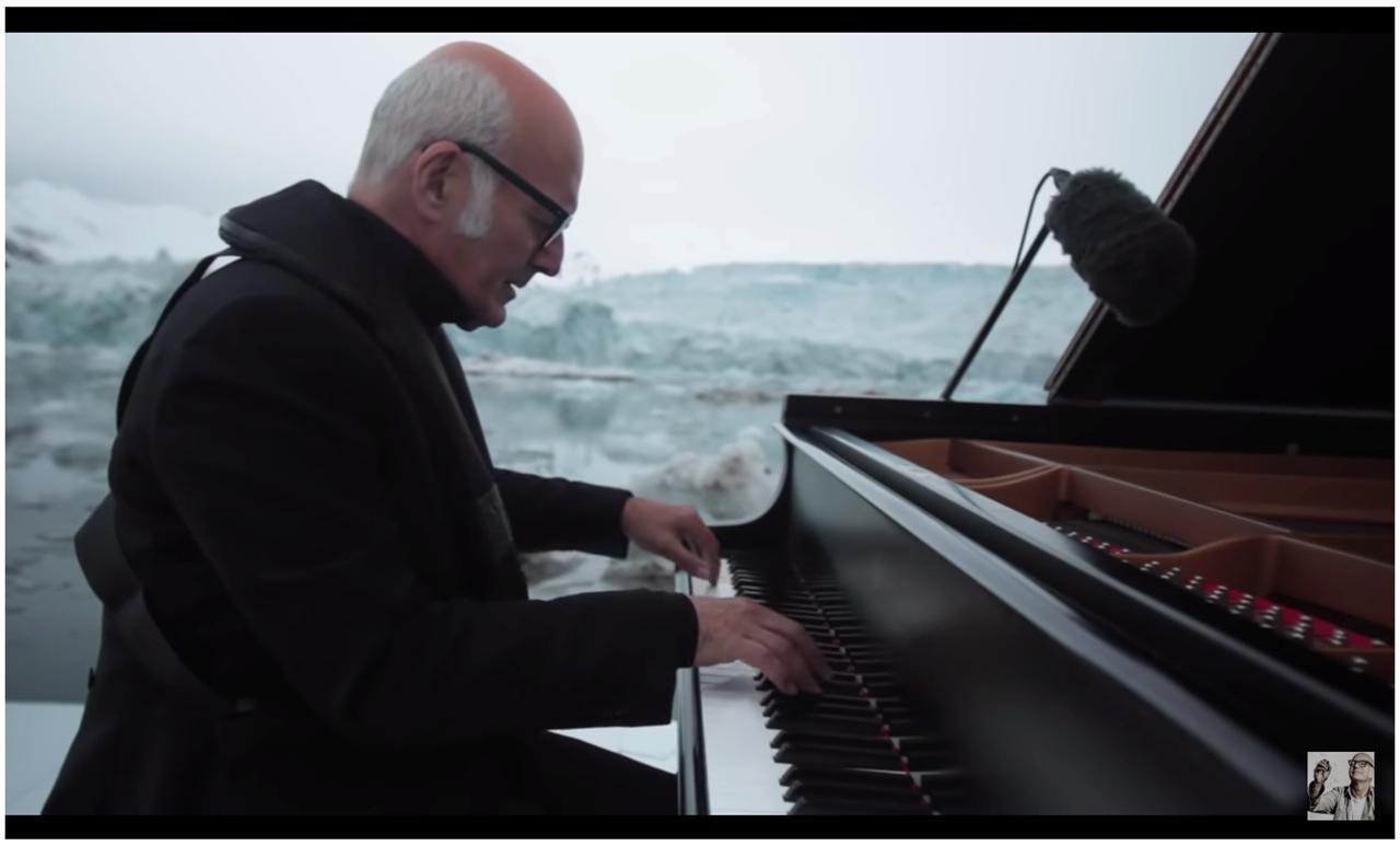 Ludovico Einaudi plays the piano in front of a glacier in Norway.