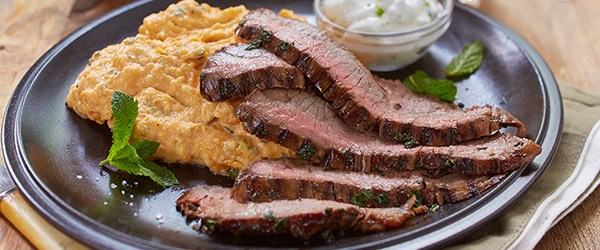 Photo of grilled steak with mashed sweet potatoes