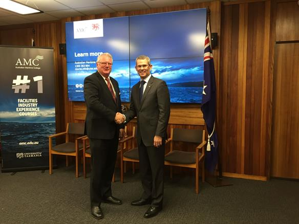 Naval Shipbuilding College project manager Bill Docalovich and AMC Principal Michael van Balen AO seal the deal