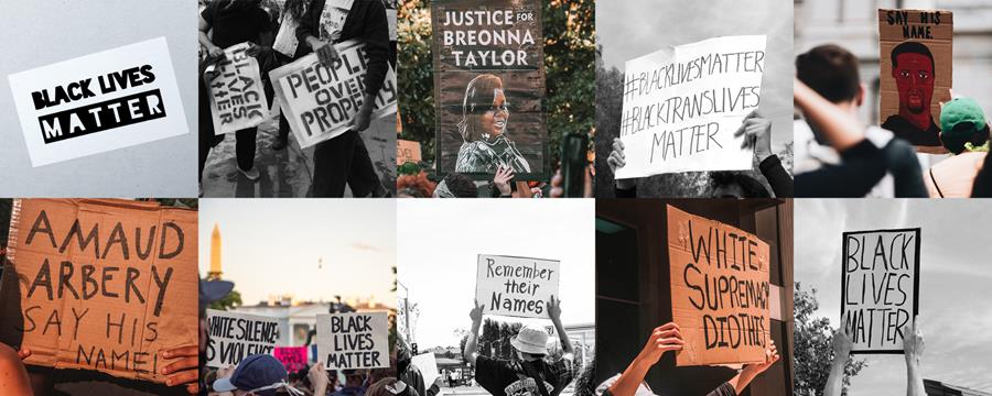Image of Black Lives Matter signs at protests. People holding signs and walking down the street.
