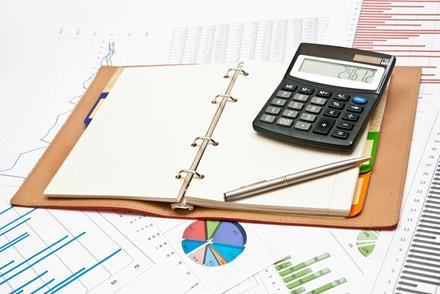 Calculator, notebook, pen and graphs