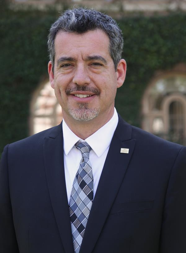 Presidential debate expert Oliver Mayer photographed wearing a business suit,
