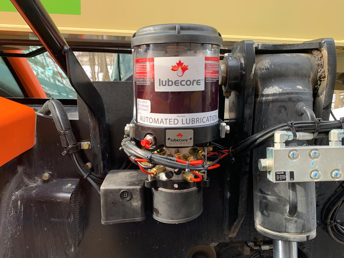 lubecore automated lubrication system installed close up on heavy equipment