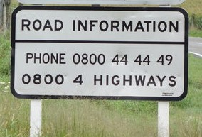 A road sign with '0800 4 HIGHWAYS' displayed.