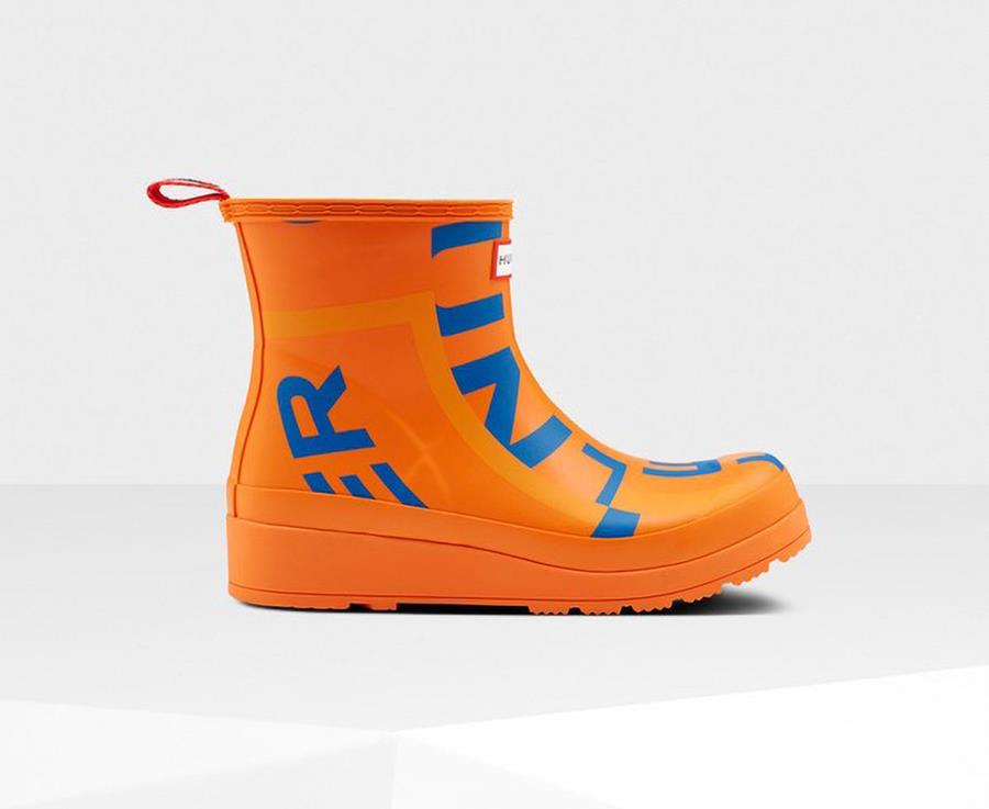 Photo of orange and blue rubber boot.