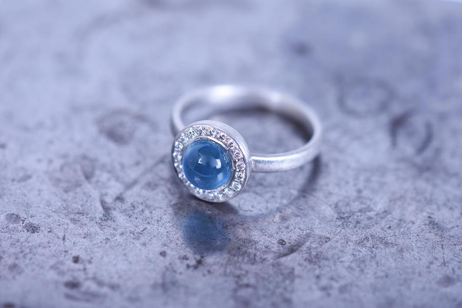 Rainbow sapphire eternity rings.