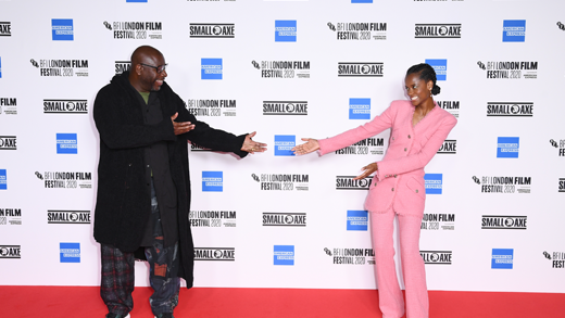 Steve McQueen and Letitia Wright pointing to each other